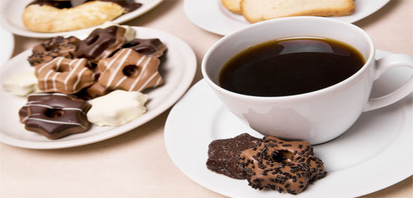 cup with coffee and sweets